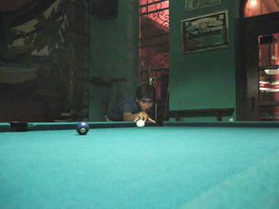 Cousing tito playing pool at El Pavo Real, Panama City