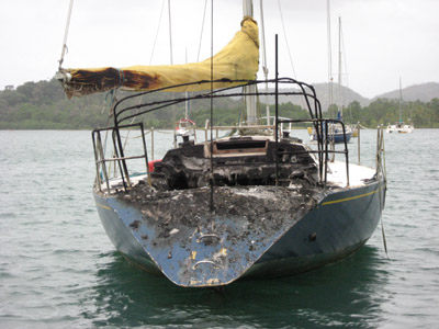 totally burned boat. Portobelo, Panama