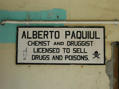 Hand Painted Sign. Alberto Paquiul Chemist and druggist liscensed to sell drugs and poisons. Dangriga Town, Belize
