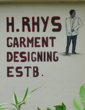 Hand Painted Sign. H. Rhys Garment designing estb. Dangriga Town, Belize