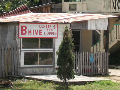 Hand Painted Sign. Bhive $ Lumber and coffin. Dangriga Town, Belize