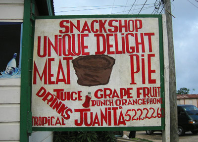 Hand Painted Sign. Unique delight meat pie. Dangriga Town, Belize