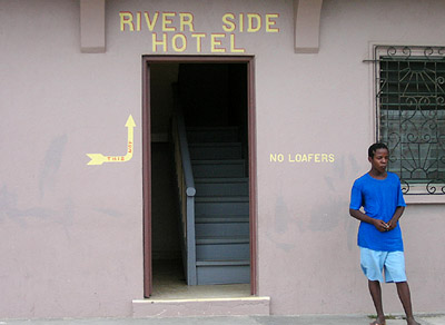 Hand Painted Sign. River Side Hotel No Loafers. Dangriga Town, Belize