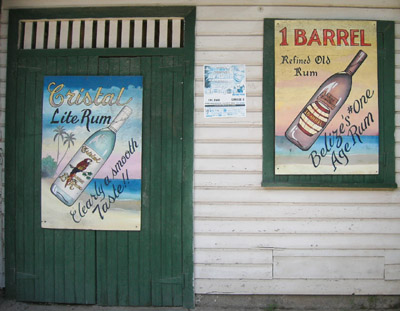Hand Painted Sign. Rum ads. Dangriga Town, Belize