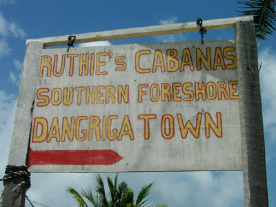 Hand Painted Sign. Ruthie's Cabanas Southern Foreshore. Dangriga Town, Belize