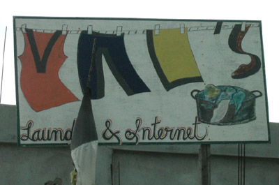 Hand Painted Sign. Vals laundry and internet. Dangriga Town, Belize