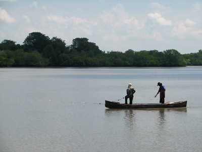 fishing from a dugout canoe. Bahia del Sol, El Salvador