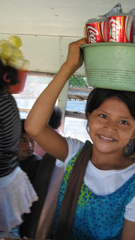 young girl vendor on the bus. El Salvador