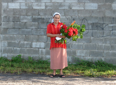 woman with flowers. El Salvador